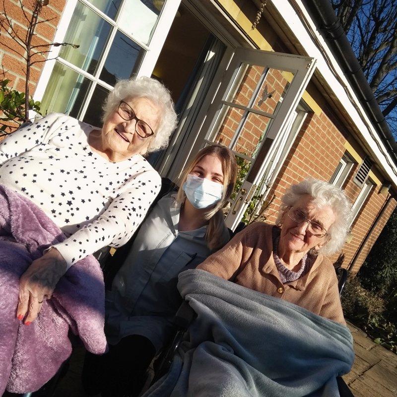St Catherines nursing home residents enjoying garden sun
